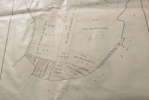1845 Enclosure map showing division of land at Oxenbourne into large holdings for Sir John Bonham Carter and Sir William Joliffe, and smaller sections for tenant farmers. One field is set aside for 'Poor Cottagers'.