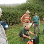 Carl Raven prepares resistivity scanning kit, watched by Tricia Blakstad, David Hopkins, Ron Ingerson and Jane Brown.