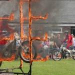 Eagle biker jumpiing through fire