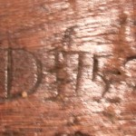 'RD' initials carved on mantel beam