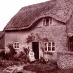 Frogmore Cottage with lady by door