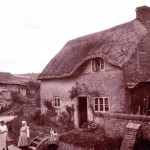 Frogmore cottage with couple in lane