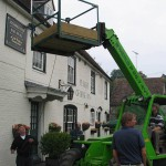 Erecting broadband aerial at Ye Olde George Inn in 2002. East Meon was the first village in Hampshire to introduce a broadband internet network.