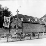 War Memorial and Goddards garage with bunting