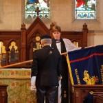 Rev Jane Ball receives the colours at St John's Langrish