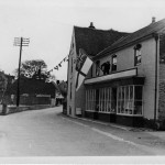 Man erecting Royal Navy Ensign on Parsons:Brooks store