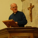The Vicar, Reverend Terry Louden, giving his talk on the History of East Meon
