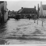 A tractor comes down the flooded High Street