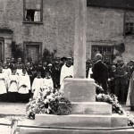 The investiture of the War Memorial in 1923. On a sign above the door of Barnards is a sign ..